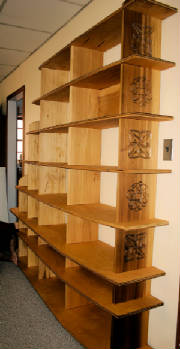 bookshelvesshowingcarvings.jpg